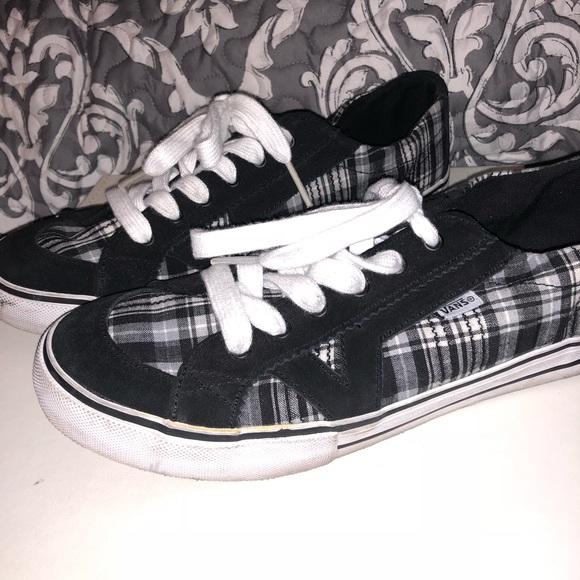 Vans black and white plaid shoes. M 5a99b8ba72ea88e1b2bee0dd f7d57e42b